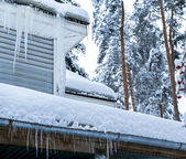 Country house with icicles — Stock Photo