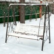 Swing covered in snow — Stock Photo