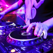 Stock Photo: Dj playing track