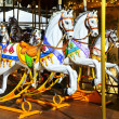 Traditional carousel with horses — Stock Photo #17879179