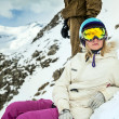 Portrait of snowboarder in winter resort - Stock Photo