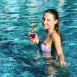 Woman with cocktail in pool — Stock Photo #20019977