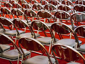 Rows of metal chairs — Stock Photo