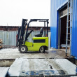 Forklift at large warehouse — Stockfoto #23149360