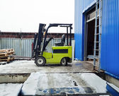Forklift at large warehouse — Stok fotoğraf