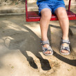 Foot baby on swing - Stock Photo