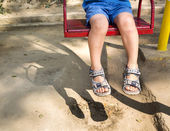 Foot baby on swing — Stock Photo