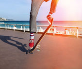Skateboarder jumping on skateboard — Stock Photo