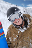 Smiling snowboarder with snowboard — Stock Photo