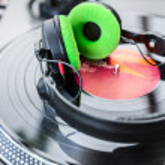 Vinyl Player with headphones — Stock Photo #28435749