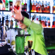 Barman professional making cocktail — Stock Photo