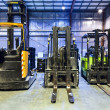 Forklifts in warehouse — Stock Photo