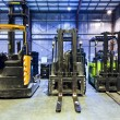 Stock Photo: Forklifts in warehouse