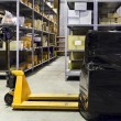 Foto Stock: Forklift on large warehouse
