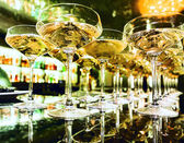 Glasses of champagne on bar — Stock Photo
