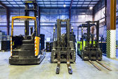Forklifts in warehouse — Foto Stock