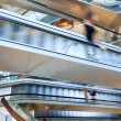 People in motion in escalators — Stock Photo #34100819