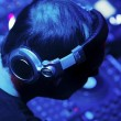 Stock Photo: Dj mixes the track