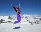 Happy woman jumping in the mountains — Stock Photo