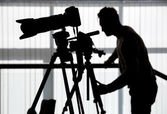 Silhouette of photographer and cameraman — Stock Photo
