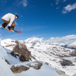 Snowboarder in the sky — Stock Photo