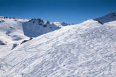 Traces of skiers in mountains — Stock Photo