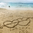 Hearts on sand near ocean — Stock Photo