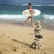 Pyramid of the corals and surfer girl with board — Stock Photo