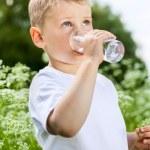Child drinking pure water — Stock Photo #44946815