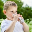 Child drinking pure water — Stock Photo #44946821