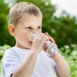 Child drinking pure water — Stock Photo #44946821