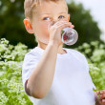 Child drinking pure water — Stock Photo #44946823