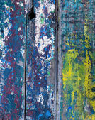 Colorful texture on wooden surface — Stock Photo