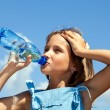 Young beautiful girl drinking water — Stock Photo #47820859