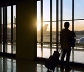 Silhouette of man near window in airport  — Stock Photo