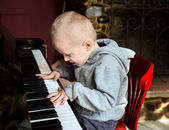 Little boy playing the piano — Stock Photo