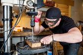 Man in work on electric drill press — Stock Photo