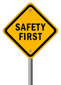 Vector safety first road sign — Stock Vector