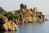 Antique tower in Cefalu rocky bay — Stock Photo