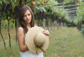 Beautiful girl portrait in a grapevine — Stock Photo