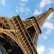 Постер, плакат: Eiffel tower against blue sky
