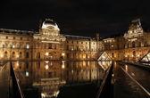 Louvre museum reflection — Stock Photo