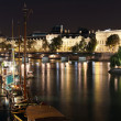 Seine river and Louvre illuminated — Stock Photo