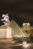 Louvre square with view of Louis XIV statue — Stock Photo