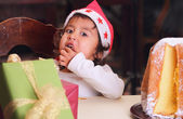 Christmas child finger licking sugar — Stock Photo