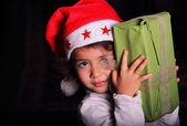 Christmas child portrait in low key — Stock Photo