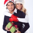 Smiling christmas couple hugged — Stock Photo