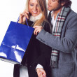Shopping couple with bags — Stock Photo