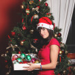 Beautiful brunette girl dressed for Christmas — Stock Photo