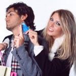 Joyful girl takes boyfriend credit card — Stock Photo #18248235